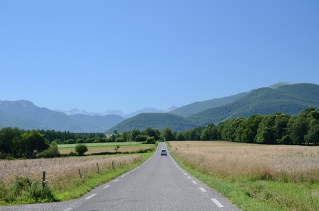 recedes: The country road recedes into the foothills of the French Pyrenees  Stock Photo