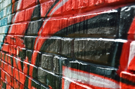 Graffiti brick wall is photographed close-up with the diminishing perspective  photo