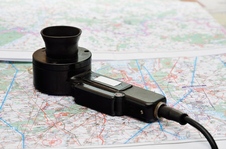 interphone: There is a telephone transmitter on the topographic map in the background