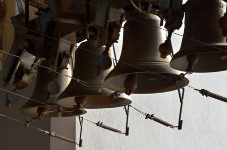 bell shaped: A carillon consists of at least 23 cast bronze, cup-shaped bells  This is the heaviest musical instruments