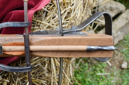 arbalest: A vintage crossbows with a bolt are photographed close-up