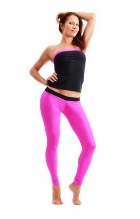 shoeless: A barefoot slim woman is standing on tiptoe  She is wearing the sport clothes for fitness