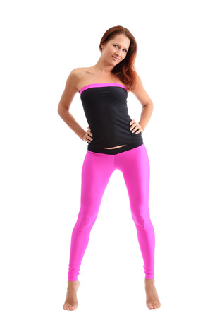 A barefoot slim woman is standing on tiptoe  She is wearing the sport clothes for fitness  photo