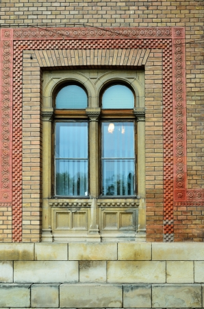 Horseshoe arch is decorated the large window  Famous building of the Chernivtsi University is the bright exemple of the Romanesque and Byzantine architecture embellished with motifs of Ukrainian folk art  photo