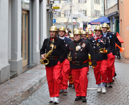 fasching: Orchestra of fire-fighters are marching in the street of German city Konstanz at the traditional funfair Fasching