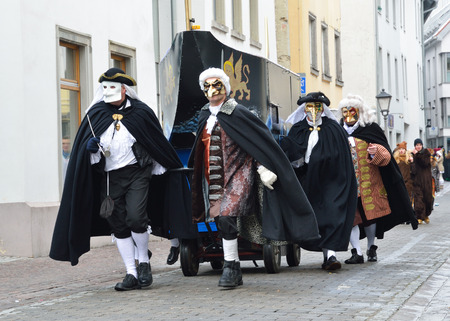 fasching: Mummers in fancy costumes are going in the street at the traditional funfair Fasching  Editorial