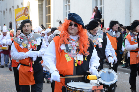fasching: Orchestra of drummers and trumpets are marching in the street of German city Konstanz at the traditional funfair Fasching