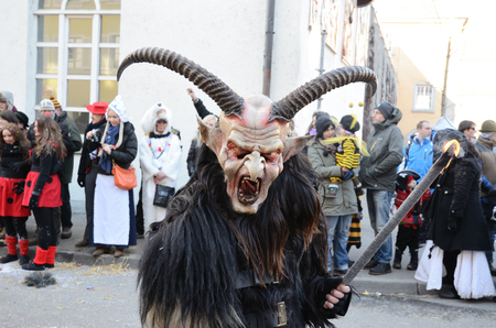 fasching: Participant of masquerade is in the street of German city Konstanz at the traditional funfair Fasching