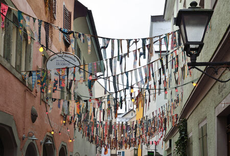 fasching: Narrow street of medieval city Konstanz is decorated with various cravats for the traditional funfair Fasching.