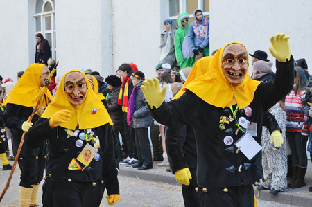 fasching: Mummers in masquerade costumes are going in the street at the traditional funfair Fasching. Editorial