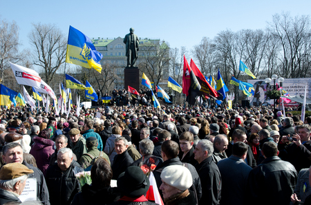 common people: Kiev, Ukraine - March 09 2014: Maidan activists, officials, diplomats and common people take part in the solemn ceremony in the Taras Shevchenkos public garden.
