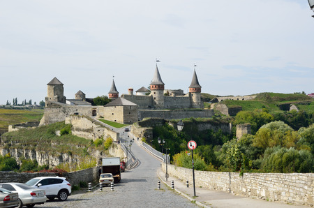 fastness: An ancient castle dominates on the green rock above the famous Ukrainian town Kamianets-Podolsky