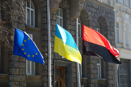 Ukrainian flag, the flag of Europe and the battle flag of the UPA are flying at the government quarter in the Ukrainian capital Kyiv  Stock Photo - 26759337