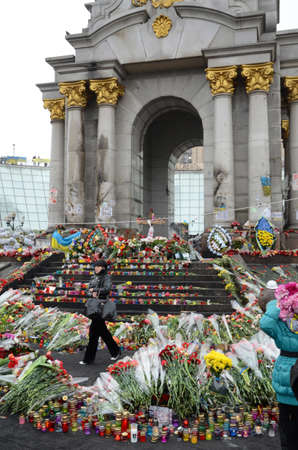 maidan: Kyiv, Ukraine - March 01 2014  Maidan is covered with a lot of flowers and commemoration candles after the shooting at the Independence square in February 2014
