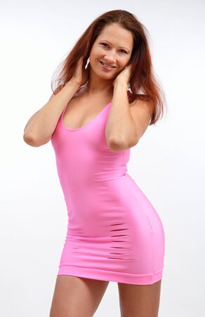 sheath: Young woman is posing in the rosy sheath short dress
