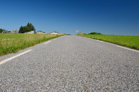 The country road is photographed close-up with diminishing\ perspective