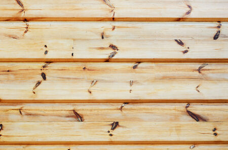 unpainted: Wood wall is made of unpainted boards