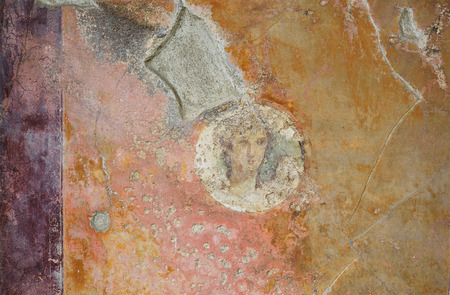 regenerated: Portrait of the young woman is preserved its original appearance on the ancient wall of a Pompeii house