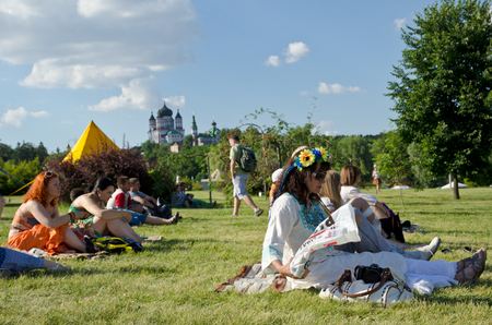 dream land: People are resting on the green lawn at the 11th International Ethnic Festival  Dream Land