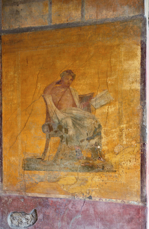 Fresco with a Roman citizen is preserved its original appearance on the ancient wall of a Pompeii house