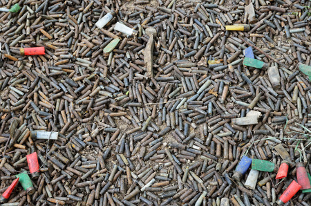 utilized: A lot of utilized cases and shells are heaped after shooting