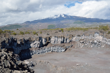 open pit: An open pit is situated close to the active volcano Etna.