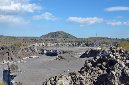 open pit: An open pit is situated on the flat slope of the active volcano Etna.
