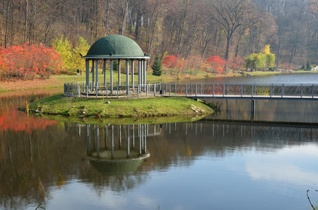 islet: The small islet with a round pavilion is reflected in the mirror surface of the landscape park Feofaniya. This is the youngest garden in Kiev. Editorial
