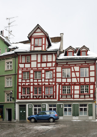 st gallen: Fachwerk in the old part of the Swiss city St Gallen or St.Gall.Timberframe house is photographed from below with diminishing perspective. Editorial