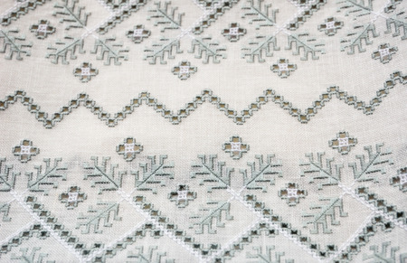 lavishly: The pale cotton cloth is lavishly embellished with cutwork embroidery.