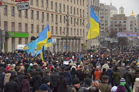 thousands: Kyiv, Ukraine - February 22 2015: Thousands of Ukrainians take part in Dignity March dedicated the victims during protests last February in the capital Kiev.