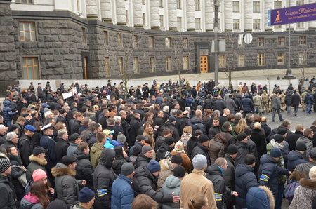 thousands: Kyiv, Ukraine - February 22 2015: Thousands of Ukrainians take part in \Dignity March\ dedicated the victims during protests last February in the capital Kiev.