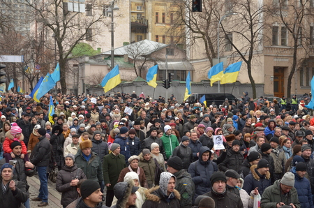 dignity: Kyiv, Ukraine - February 22 2015: Thousands of Ukrainians take part in \Dignity March\ dedicated the victims during protests last February in the capital Kiev.
