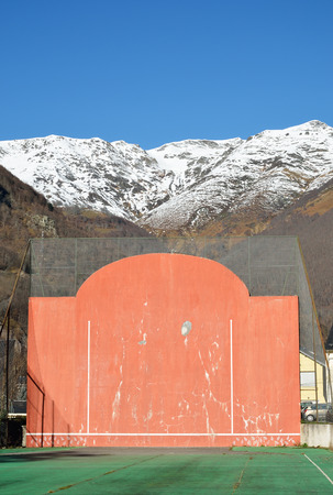 The open-air single walled fronton for Basque pelota is photographed in Cauterets.