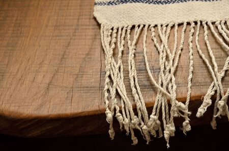 purl: Ukrainian homespun towel with fringe on the vintage wooden tabletop