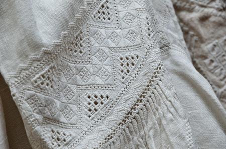 lavishly: The vintage Ukrainian shirts are lavishly embellished with traditional whitework embroidery. Stock Photo