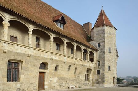 decorative balcony: The French ancient castle of the Renaissance style is located in the town Nerac. This is a wing of the original fortress with a round tower and an arcaded balcony with decorative columns. Editorial