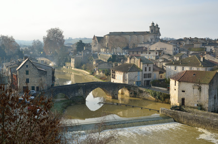 townhouses: There are old townhouses, an ancient bridge and a medieval castle in the French town Nerac lying on both sides of the Baise River. Stock Photo