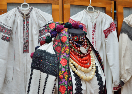 national costume: The primary object of the Ukrainian national costume is the shirt or vyshyvanka. The shirt is decorated with embroidery and a lot of chaplets and ribbons. Stock Photo