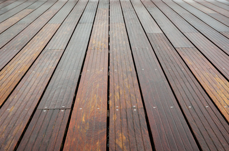 diminishing perspective: The wet planks of the batten platform are photographed with diminishing perspective.