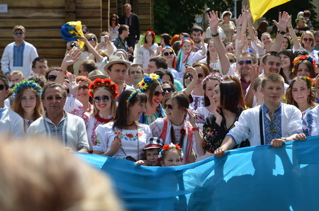 garments: Kiev Ukraine  May 24 2015: Ukrainian people in traditional garments take part at Megamarch of embroideries in Kyiv. Editorial