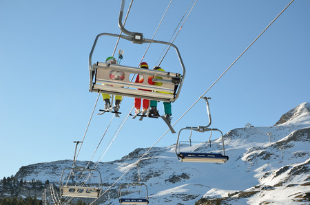 transported: People are being transported with a chair lift up the snowy slope in the ski resort Pierre Saint Martin. Stock Photo