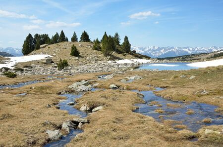 tourism in andorra: The upper part of the ValldeMadriuPerafitaClaror is an exposed glacial landscape with snowfields and streams. Stock Photo
