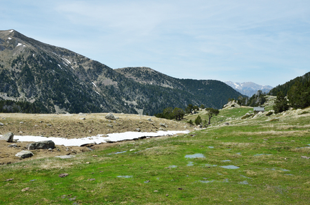 upland: In the upper part of the Vall-de-Madriu-Perafita-Claror there are the high-altitude valleys with the snow fields, glacial streams and flooding upland. Stock Photo