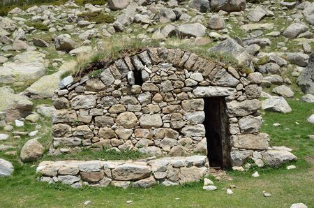 tourism in andorra: The small refuge is built from stones in the upper part of the Vall-de-Madriu-Perafita-Claror. Stock Photo