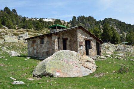 refuge: The tourist refuge and a big stone with markers in the upper part of the Vall-de-Madriu-Perafita-Claror.