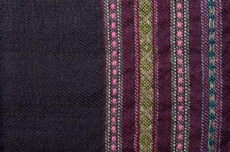 homespun: Texture of the black vintage homespun wool textile with varoius colored stripes