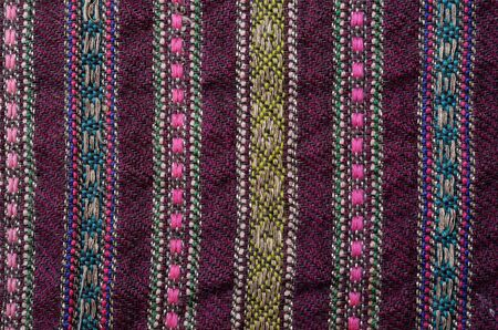 homespun: Texture of the vintage homespun wool textile with various vertical colored stripes Stock Photo