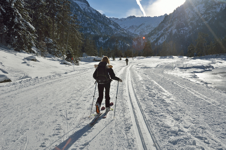 forested: A woman is skiing at the groomed trail in the snowy Marcadau valley.