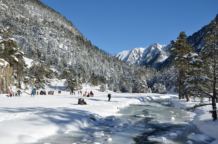 water skiers: Marcadau valley is a favorite place for cross country skiing and snow-shoe walking at both sides of Gave Marcadau in the Pyrenees national park. Stock Photo